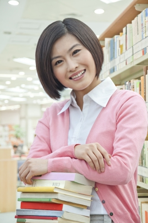 Portrait of Smiling Young Woman in Library photo