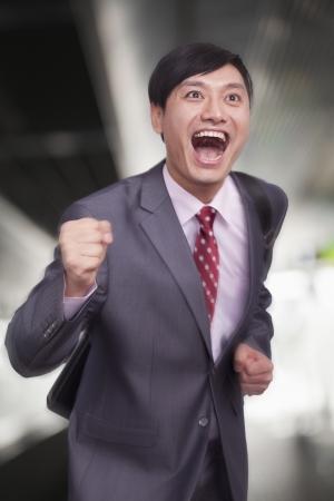 businessman running: Young businessman running, Beijing Stock Photo
