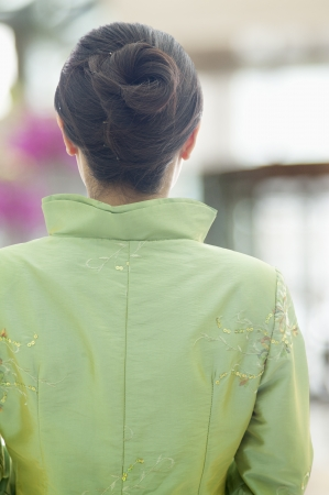 view from behind: RestaurantHotel Hostess in Traditional Chinese Clothing, View From Behind