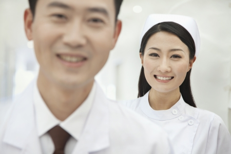 Portrait of Nurse, Doctor in Foreground photo