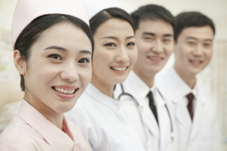 healthcare workers: Healthcare workers standing in a row, China
