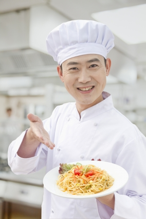 Chef showing prepared food