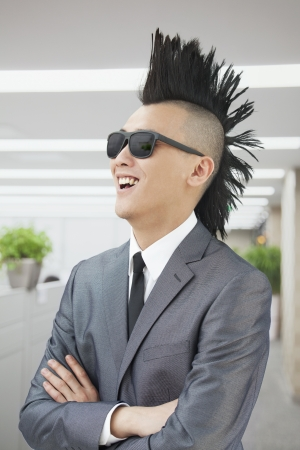 mohawk: Well-dressed young man with Mohawk and sunglasses smiling Stock Photo