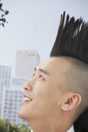 spiky hair: Young man with Mohawk close-up