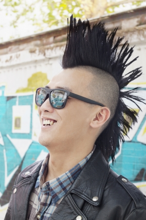 spiky hair: Young man with punk Mohawk smiling Stock Photo