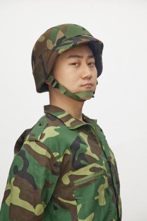 military uniform: Portrait of man in military uniform, studio shot Stock Photo