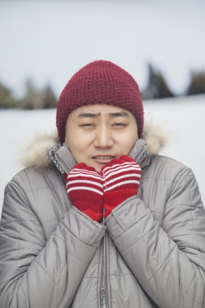 shivering: Portrait of young man shivering in cold temperature