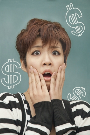 Portrait of young woman with money problems