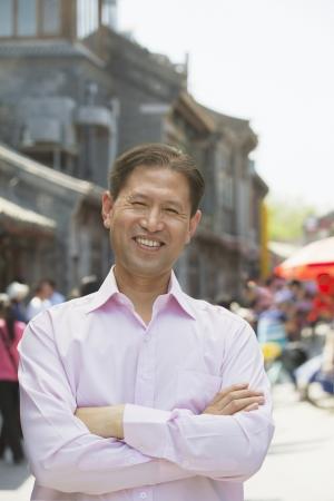 incidental people: Portrait of smiling mature man standing in outdoors in Beijing Stock Photo