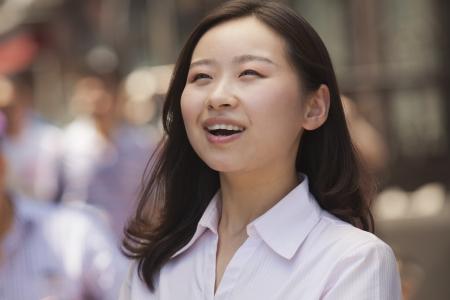incidental people: Portrait of happy young women on the street, Beijing Stock Photo