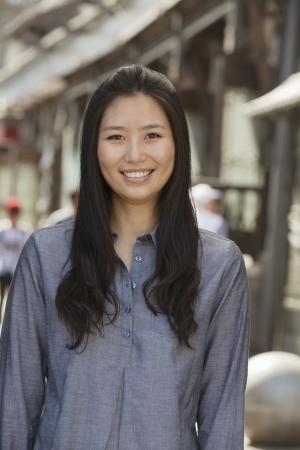 incidental people: Portrait of smiling young women outdoors, Beijing Stock Photo