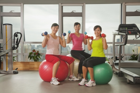mature women exercising with fitness ball photo