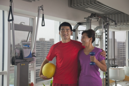 mature women: Mature women with her trainer after working out Stock Photo
