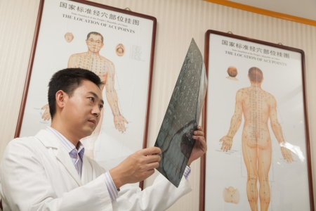 Doctor Looking at X-Ray Stock Photo - 21369428