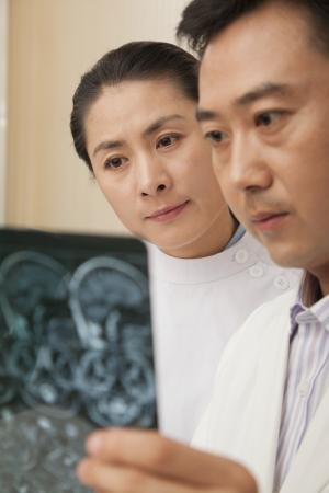 Doctor and Nurse Examine an X-Ray Stock Photo - 21369451