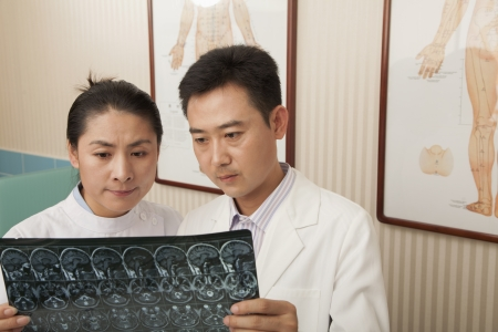Doctor and Nurse Examine an X-Ray Stock Photo - 21369436