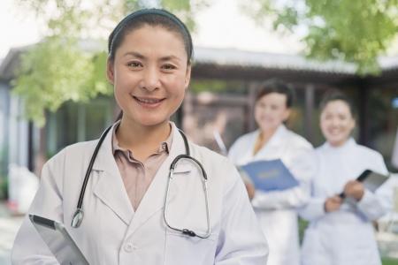 alternative medicine: Portrait of Doctor in Courtyard Stock Photo
