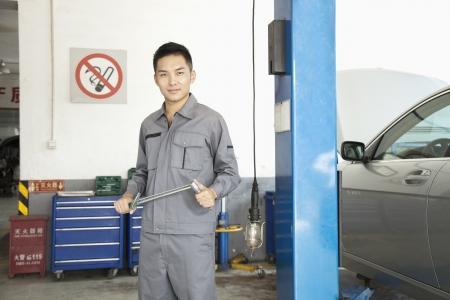 shop skill: Portrait of Garage Mechanic Stock Photo