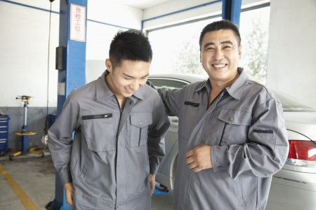 Two Garage Mechanics