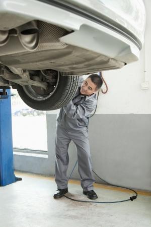 adjusting: Mechanic Adjusting Tire