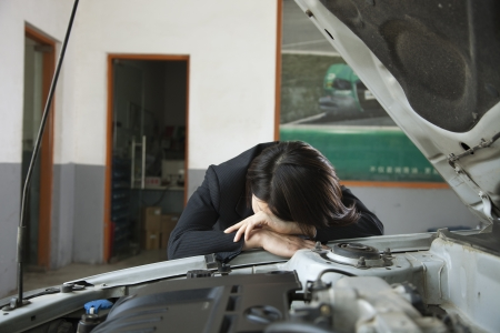 Businesswoman Frustrated with Car photo