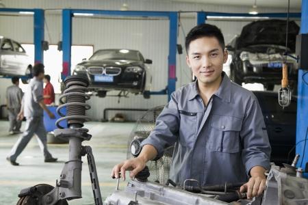 Mechanic Fixing Car Engine photo