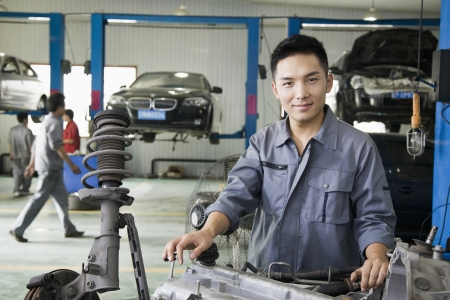 portrait man: Mechanic Fixing Car Engine Stock Photo