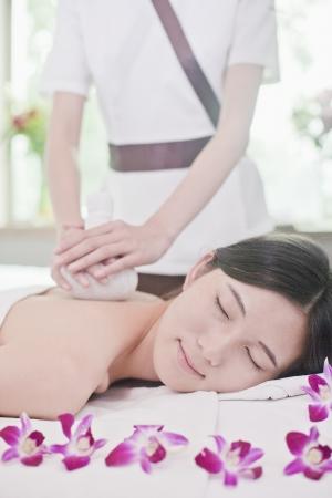 Women Receiving Herbal Massage photo