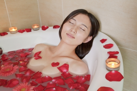 woman bathing: Young Woman Bathing at Health Spa Stock Photo