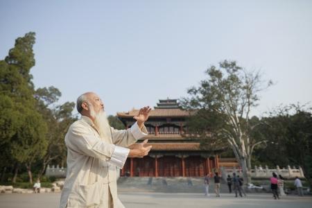 practicing: Senior Man Practicing Tai Ji