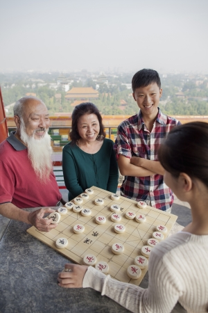 Chinese Family Playing Chinese Chess (Xiang Qi) photo