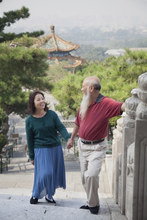 old couple walking: Old Couple Walking In Jing Shan Park