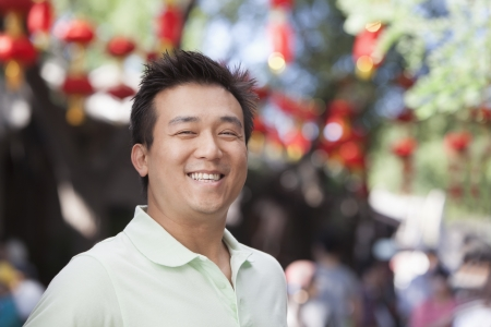 incidental people: Laughing Mid Adult Man in Nanluoguxiang, Beijing
