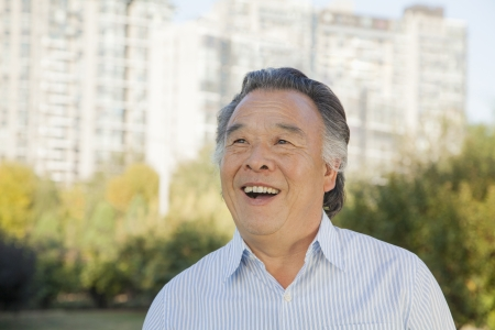 clear away: Senior man looking at the sky, portrait Stock Photo