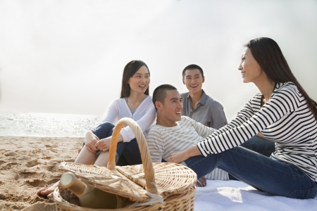 Young Friends Picnic on the Beach photo