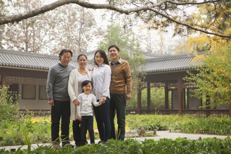 Happy family in garden photo