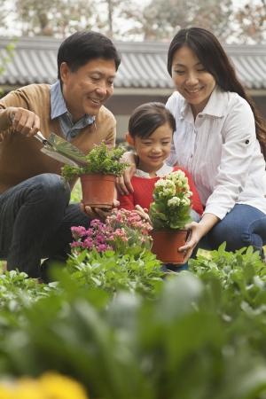 Happy family in garden Imagens