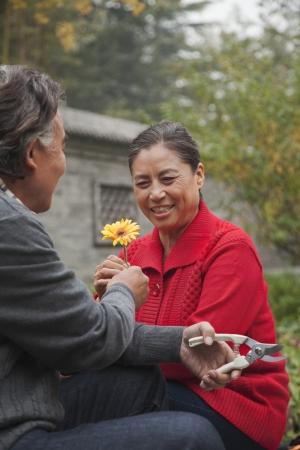 Happy Senior couple with flower