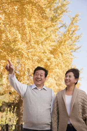 Mature Couple Walking Together in the Park photo
