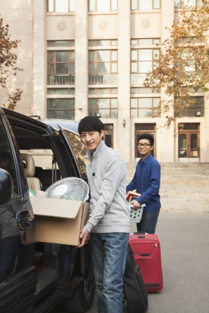 dormitory: Students moving into dormitory on college campus