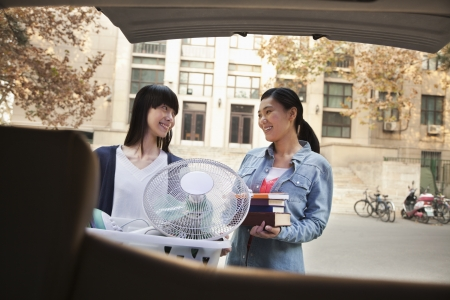 dormitory: Sisters moving into dormitory at college Stock Photo