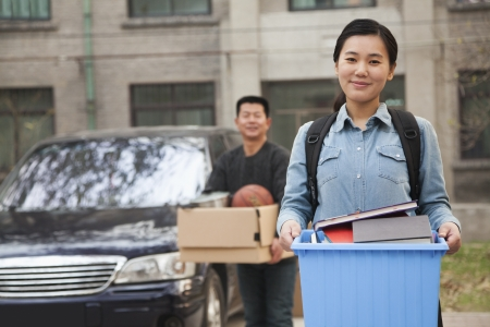 Student portrait in front of dormitory at college Stock Photo