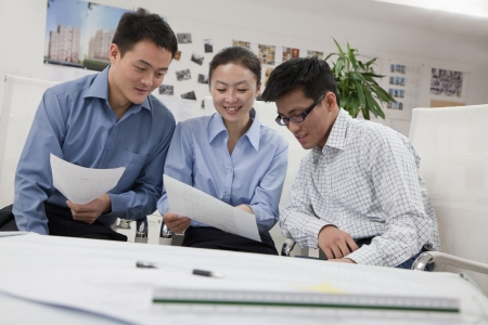 Coworkers discussing project in the office photo