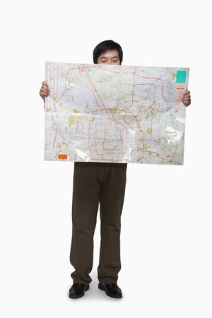 obscured face: Man holding map