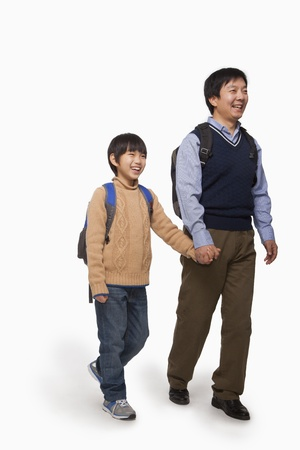 father and son holding hands: Father and son holding hands and walking