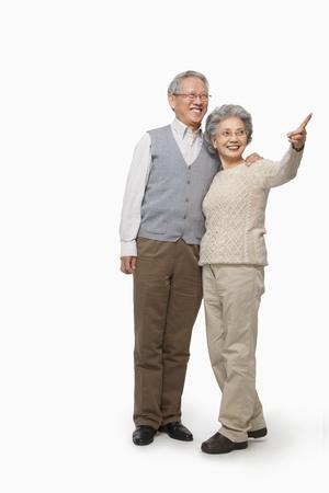 80 plus years: Senior couple pointing