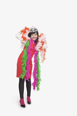 boas: Girl wearing feather boas and tiara