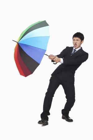 Businessman with colorful umbrella photo