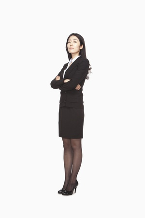 businesswoman standing: Businesswoman standing with arms crossed Stock Photo