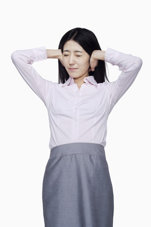 hands covering ears: Businesswoman covering ears with hands
